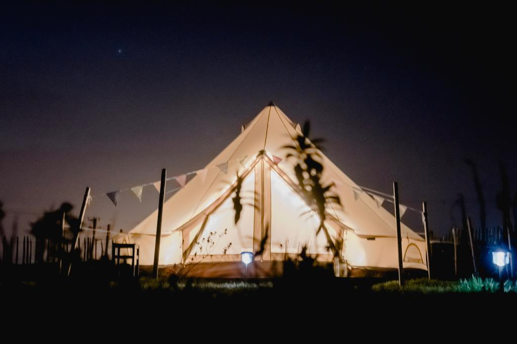 carrowmena-bell-tent-surrounded-by-bunting-at-night