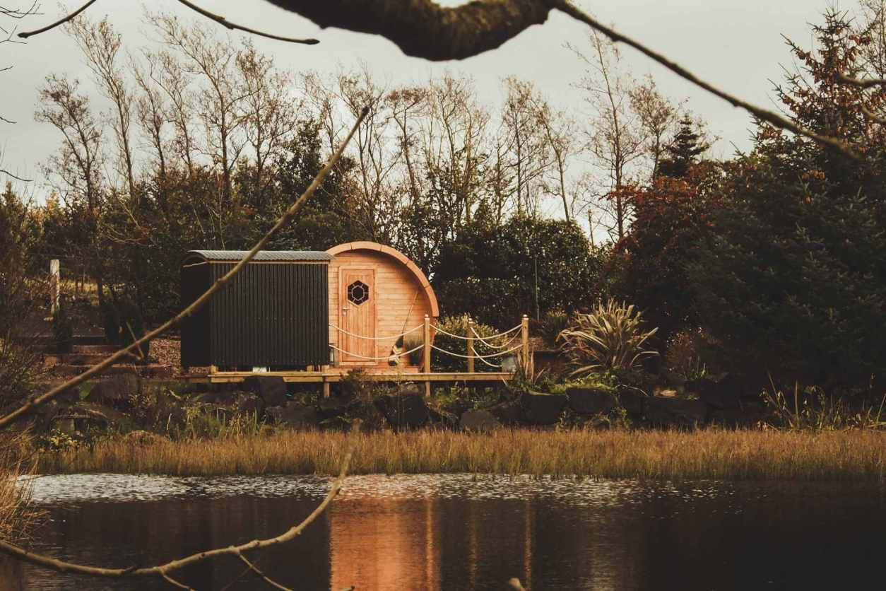 circular-pod-on-decking-by-lake-pod-on-the-pond-glamping-northern-ireland