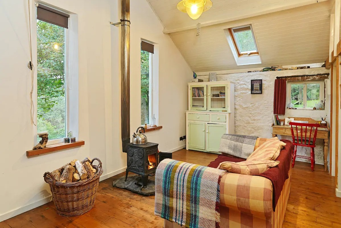 cosy-converted-cowshed-in-fintown-with-woodburner-and-sofa
