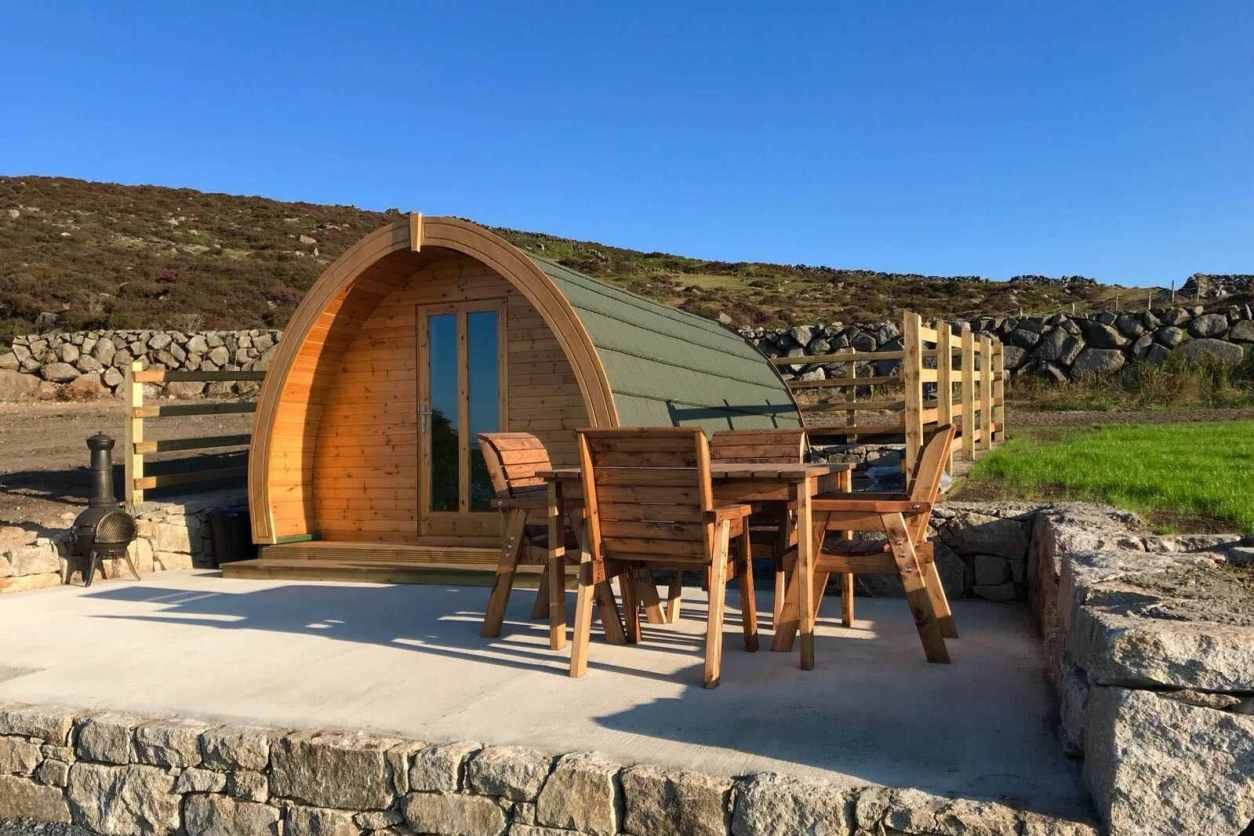 glamping-pod-on-decking-with-table-and-chairs-on-hillside-carrick-little-glamping