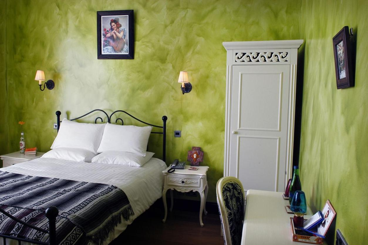 rustic-bedroom-with-green-walls-church-street-hotel