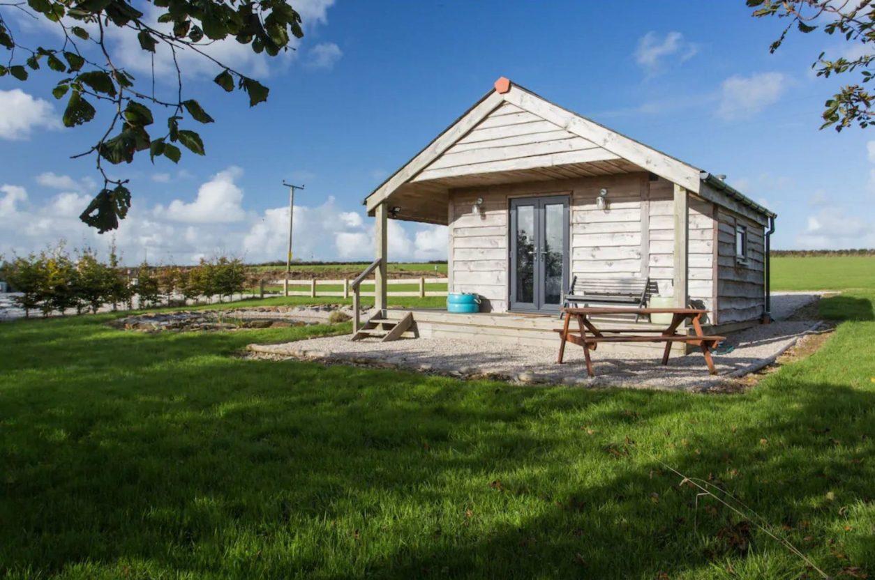 small-hut-by-pond-in-field-hawks-nest-cabin-in-saint-issey-wadebridge