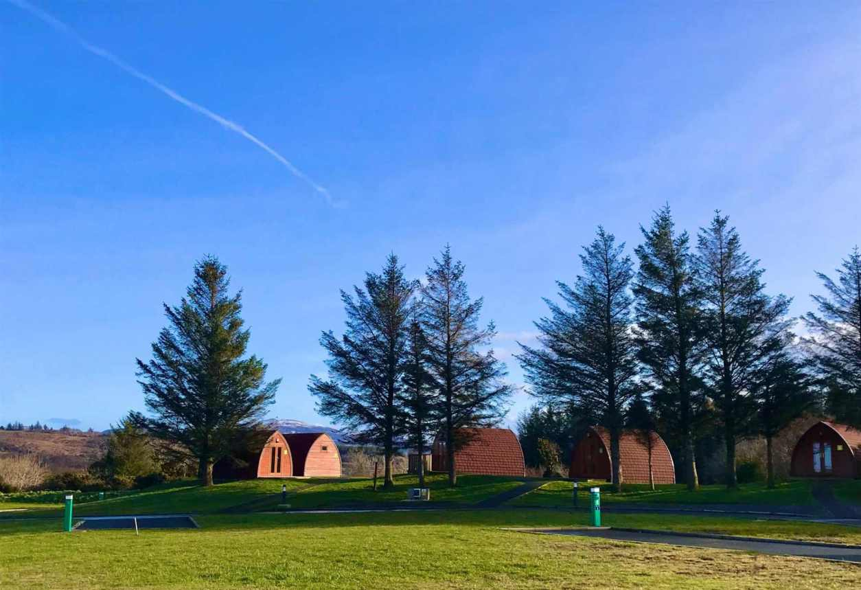 wild-atlantic-camp-pods-amid-trees-on-sunny-days-glamping-donegal