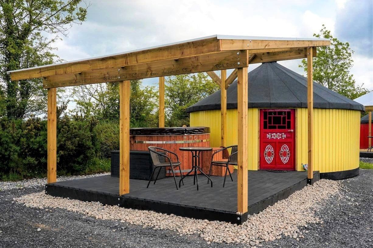 yellow-yurt-with-red-door-and-outdoor-hot-tub-yurty-ahern