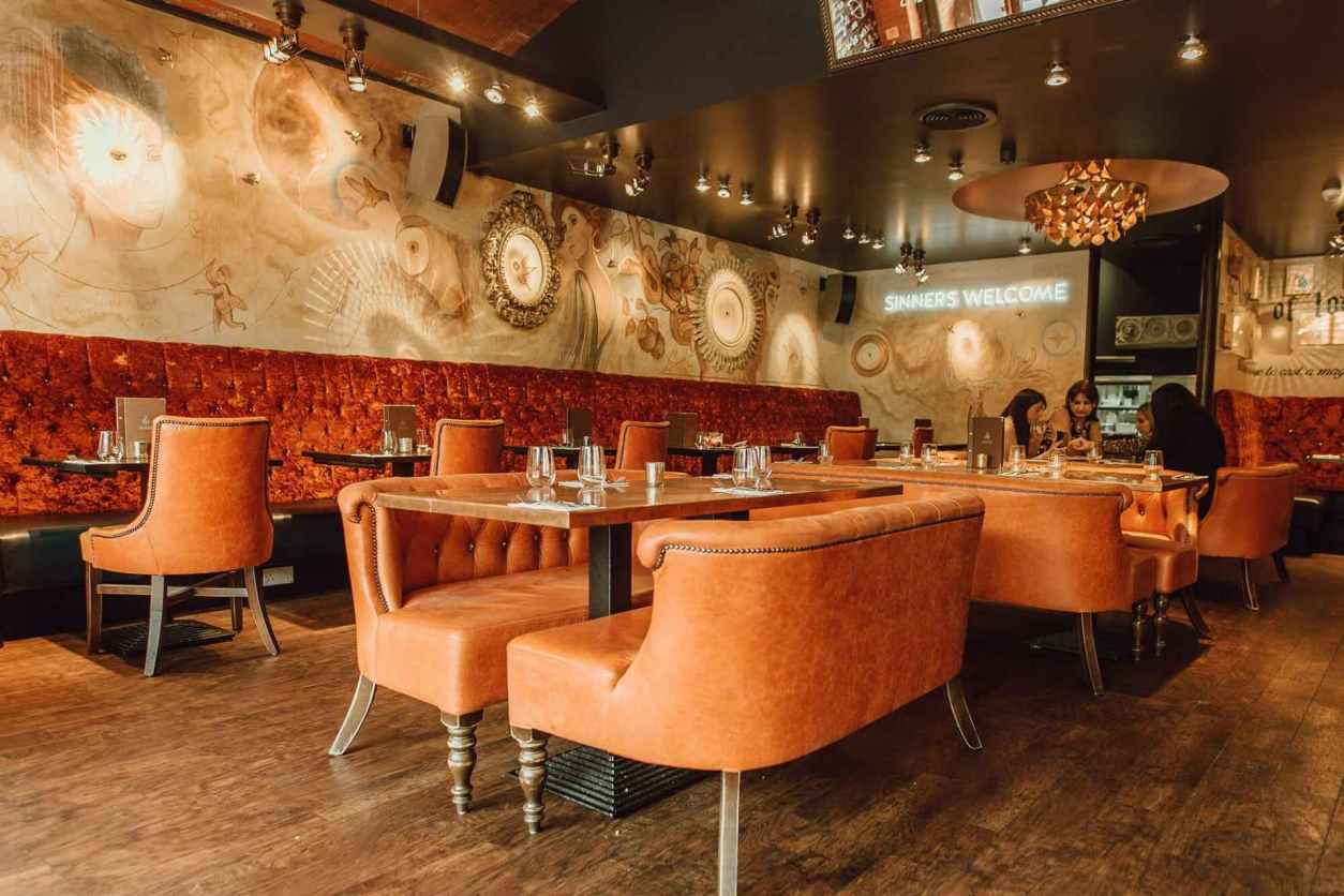 aluna-restaurant-and-cocktail-bar-with-orange-sofas-and-tables