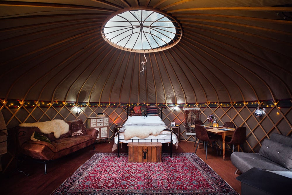 bedroom-and-living-area-of-wildwood-at-the-yurt-sanctuary-somerset-glamping