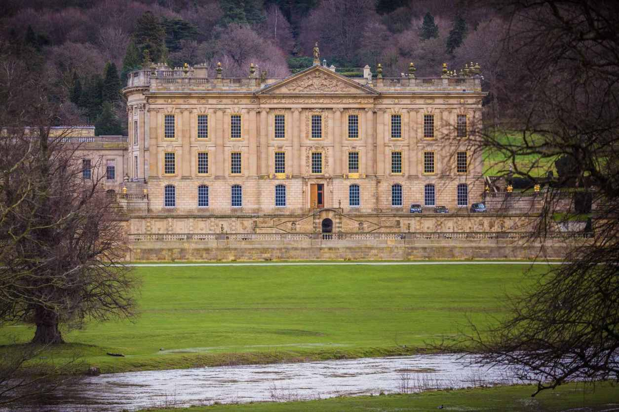 chatsworth-house-with-green-grounds-and-stream-in-foreground