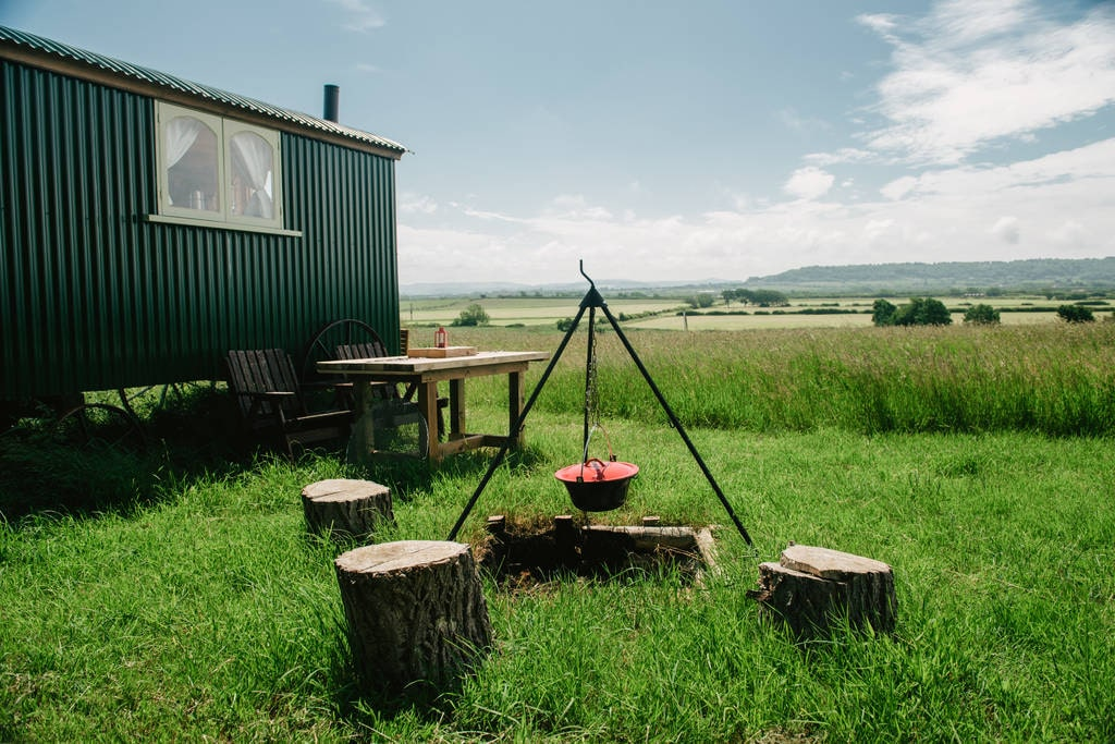 green-crooks-view-shepherds-hut-by-campfire-on-woodspring-farm-in-countryside