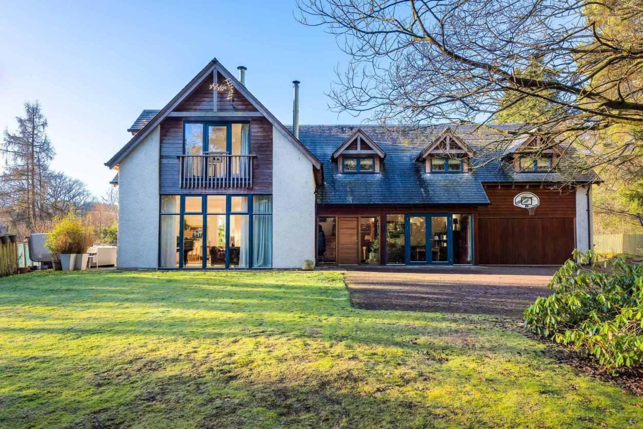 large-glenardle-lodge-with-garden-on-sunny-day