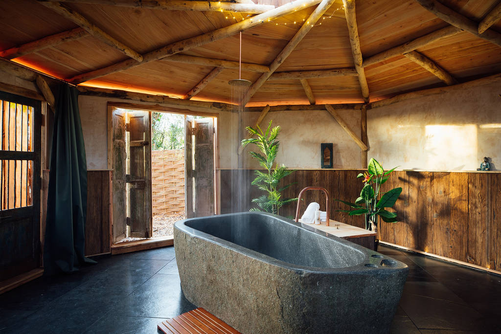 large-stone-bathtub-in-round-vilberie-cabin-at-the-orchard-glamping-somerset