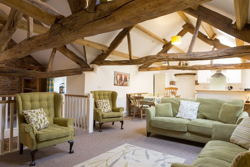 living-area-of-barn-conversion-with-green-seating-in-skelton-penrith