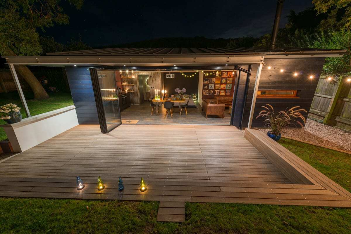 paradise-garage-tiny-house-lit-up-at-night