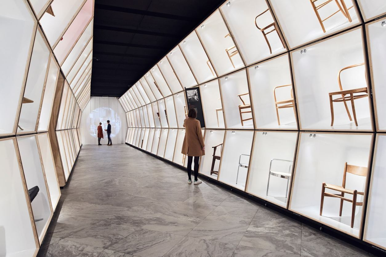 people-walking-around-the-danish-chair-exhibit-at-designmuseum-danmark