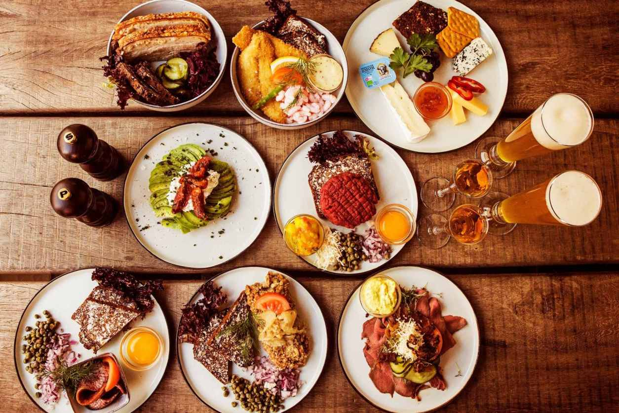 plates-of-food-on-wooden-table-at-restaurant-m-3-days-in-copenhagen-itinerary