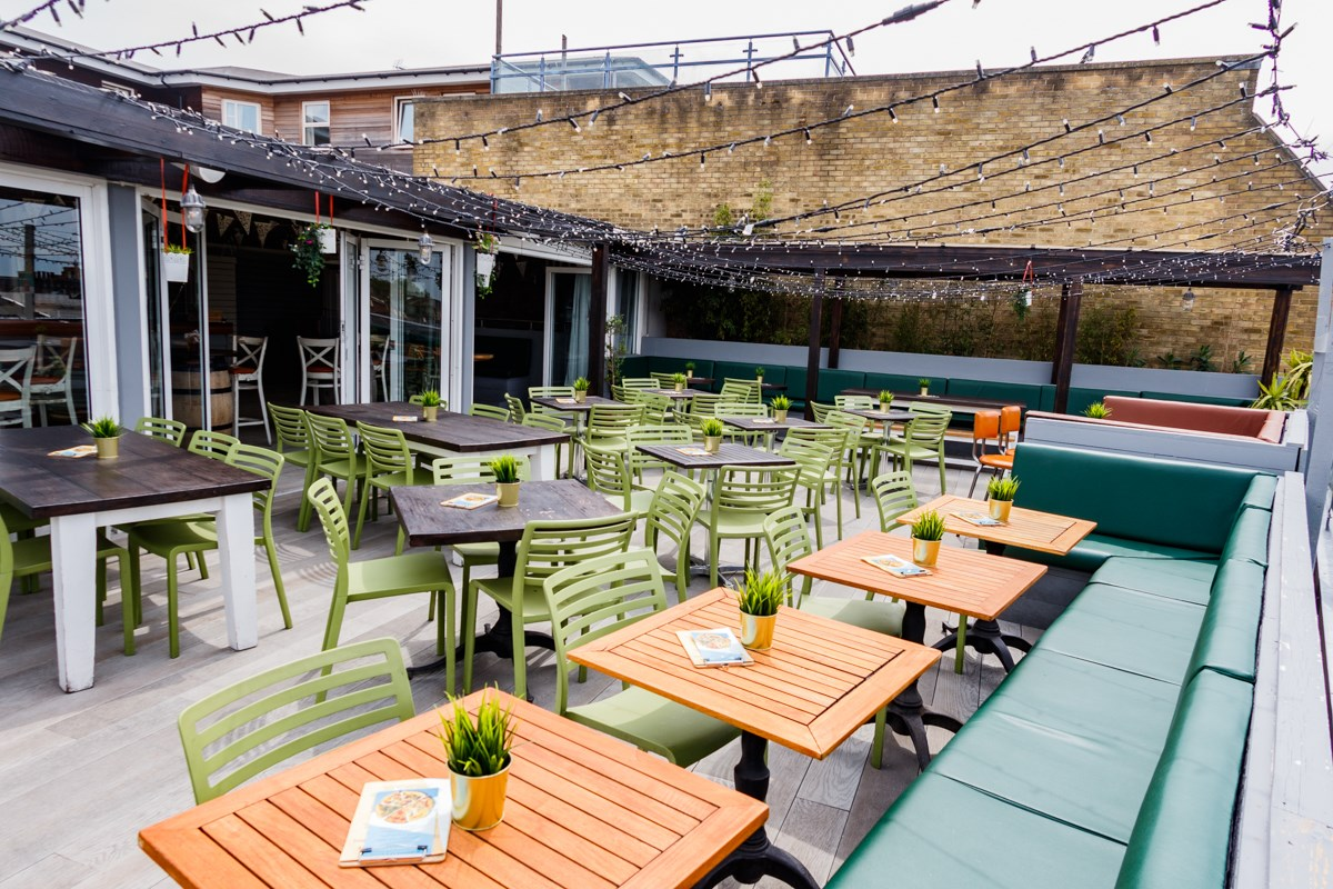 rooftop-sky-bar-with-restaurant-tables-at-revolution-bottomless-brunch-southampton