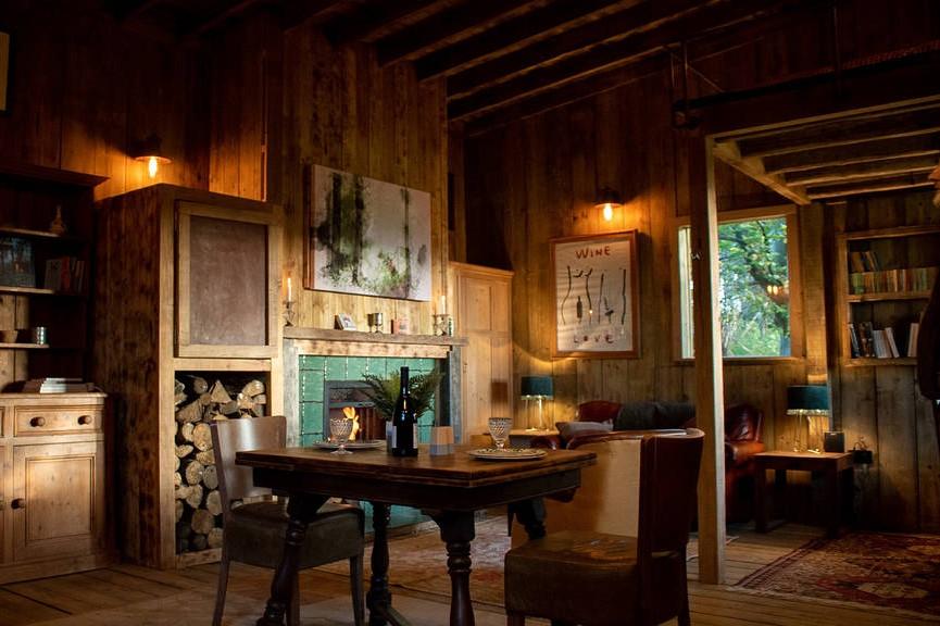 rustic-living-area-of-wooden-cabin-in-piggy-woods