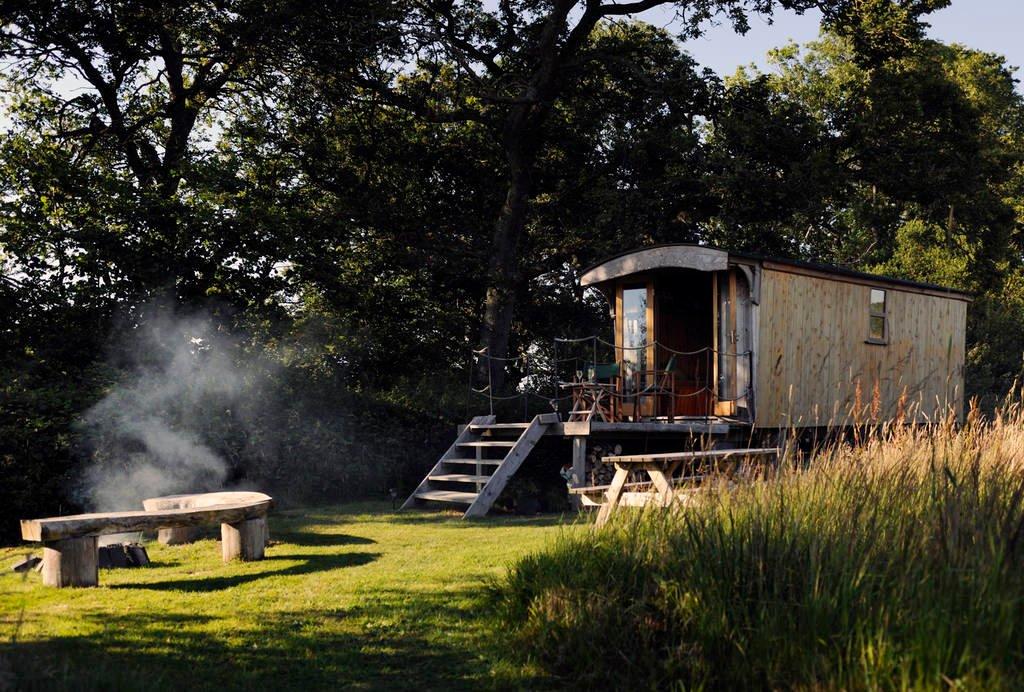 sawpits-wagon-by-campfire-in-field-in-sturminster-newton