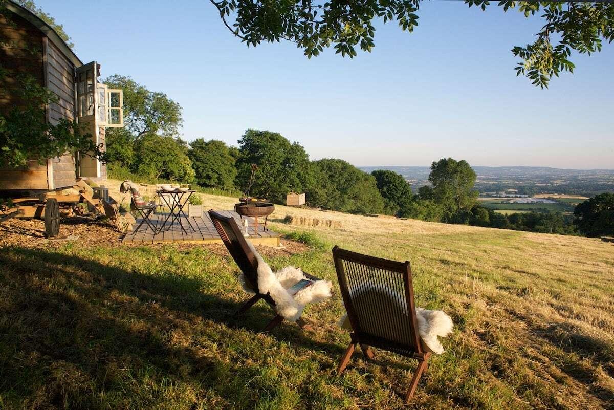 seating-outside-tilbury-farm-shepherds-hut-overlooking-countryside-views