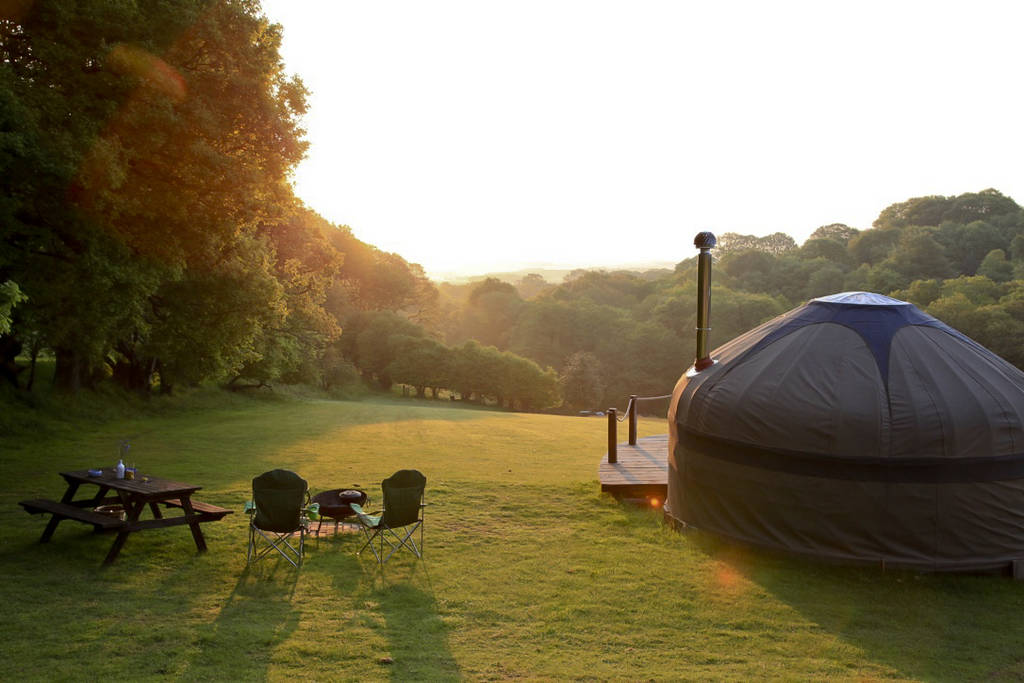 sunrise-over-deers-leap-yurt-in-rolling-countryside-and-ancient-woodland
