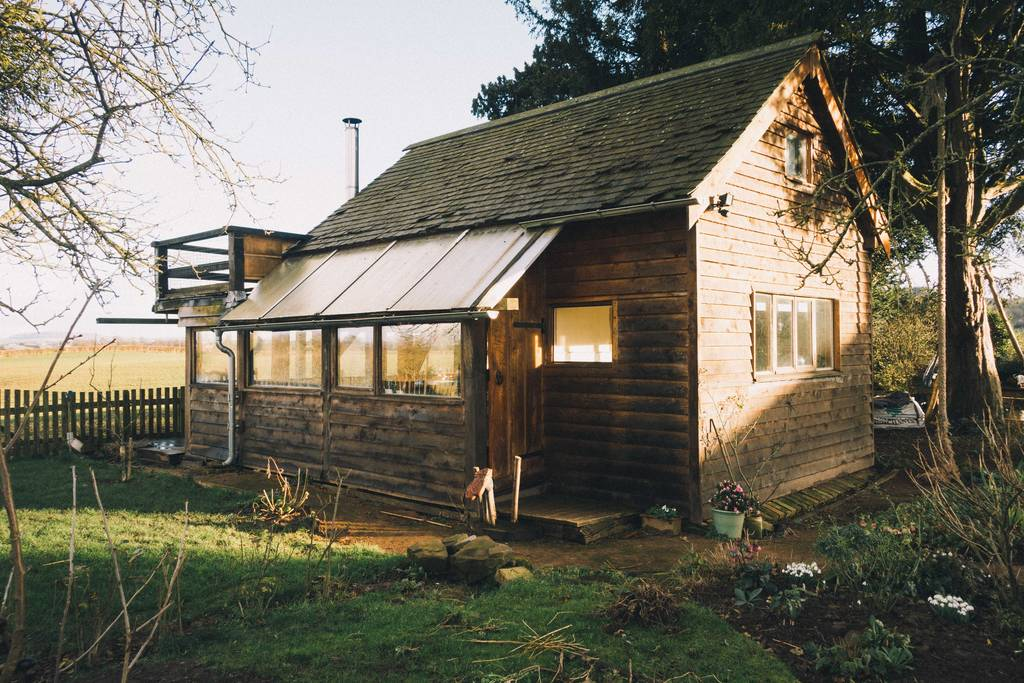 the-potting-shed-cabin-in-field-on-sunny-day