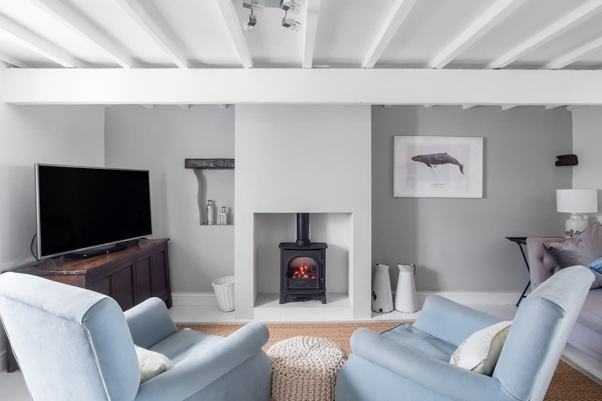 woodburner-in-living-area-in-reimagined-1715-beachfront-cottage-with-terrace-in-ravenglass-cumbria-airbnbs-lake-district