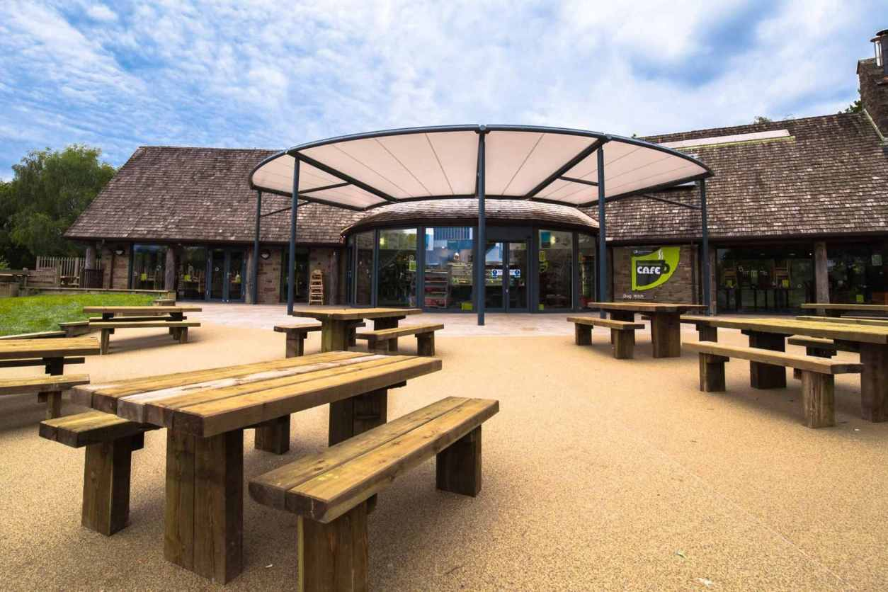 wooden-picnic-tables-outside-entrance-to-beechenhurst