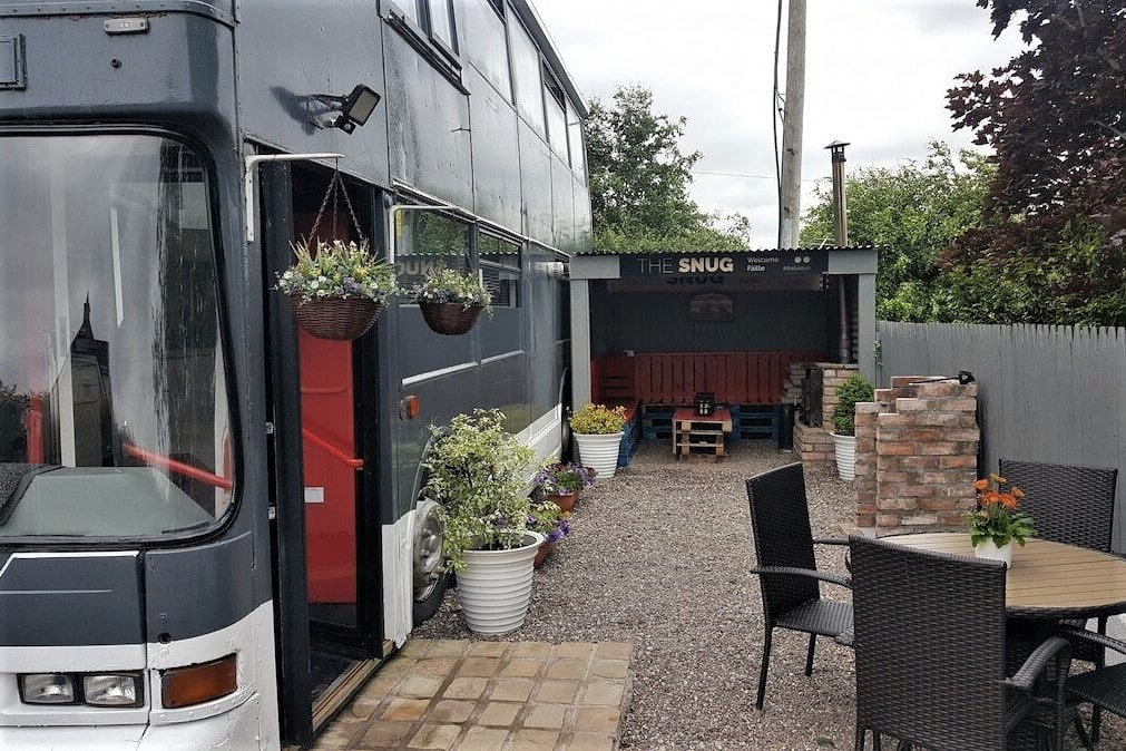 converted-grey-lux-bus-with-outdoor-seating-area