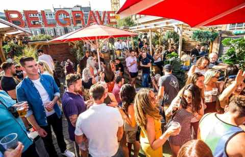 crowds-of-people-drinking-on-rooftop-of-belgrave-music-hall-and-canteen-rooftop-bars-leeds