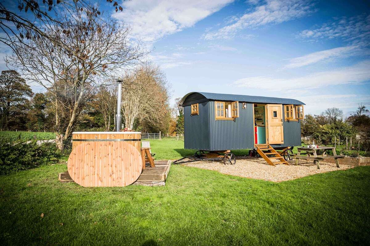exterior-of-mill-laine-farm-shepherds-hut-with-hot-tub-in-field-glamping-sussex