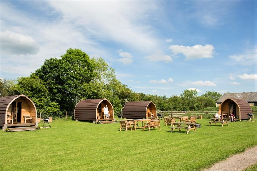 four-rosebud-meadow-glamping-pods-in-field