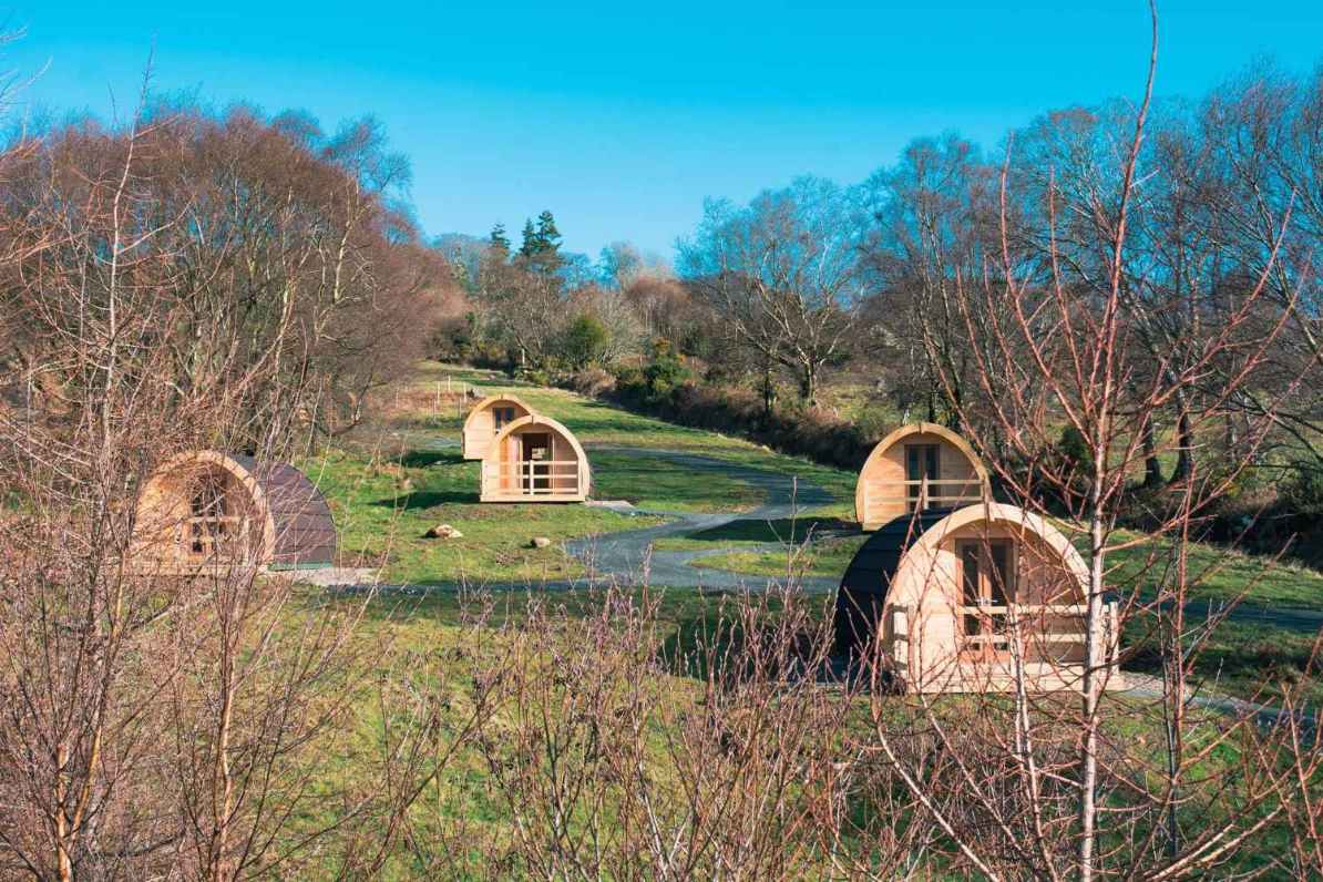 glendalough-glamping-pods-on-hill-on-sunny-day