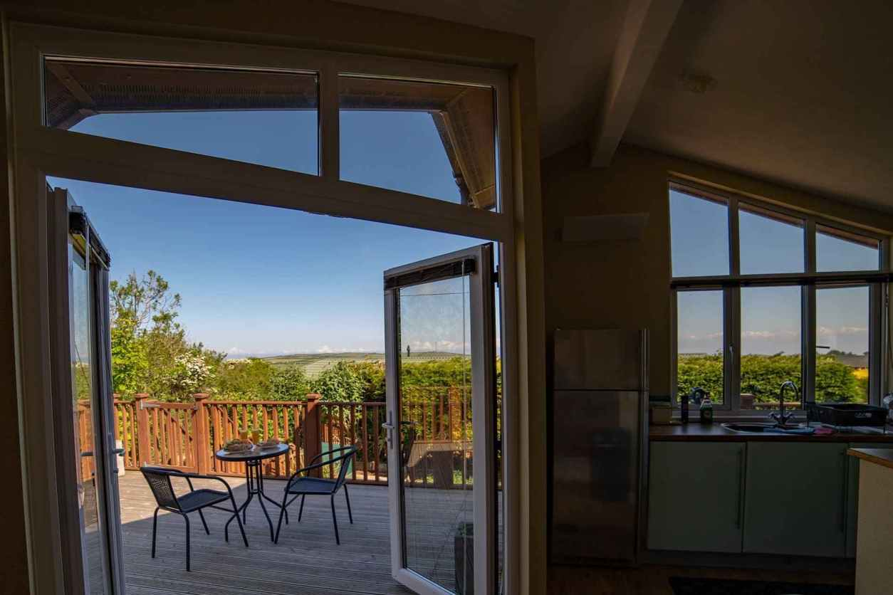 kitchen-leading-out-to-terrace-at-mullacott-park-lodges