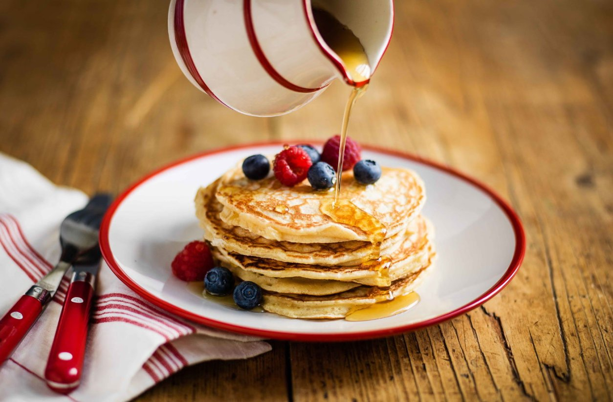 maple-syrup-pouring-on-american-pancakes-at-the-graze-inn