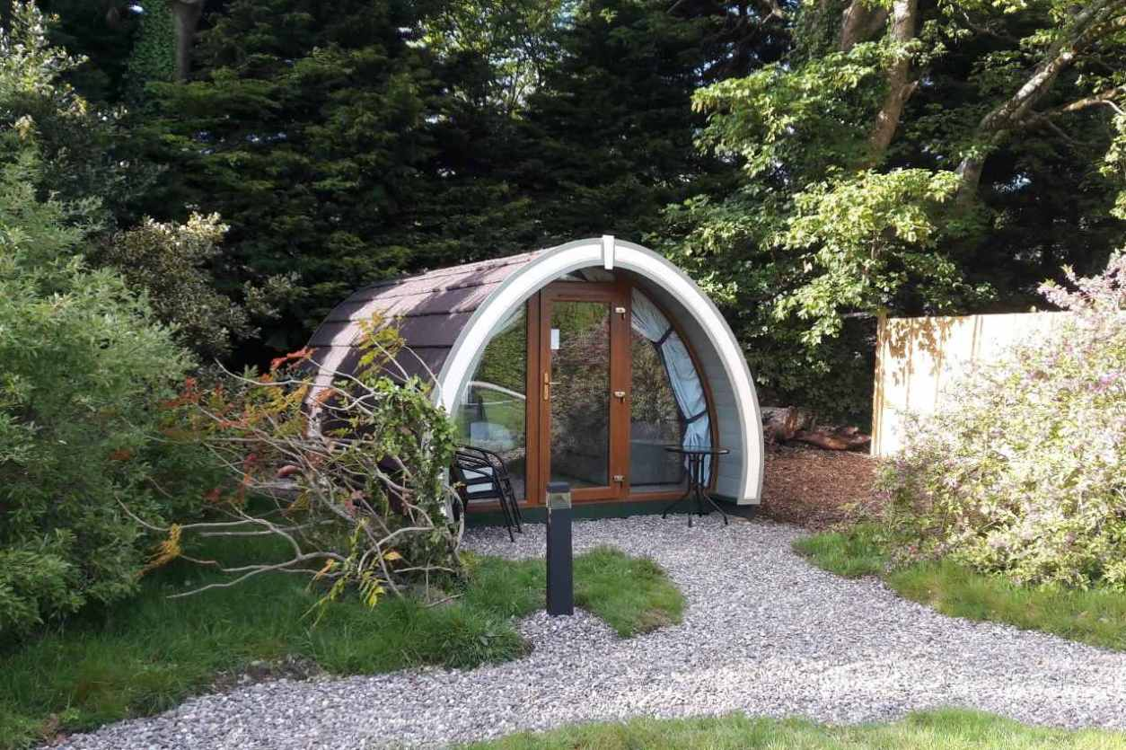 path-leading-to-priory-glamping-pod-amid-trees