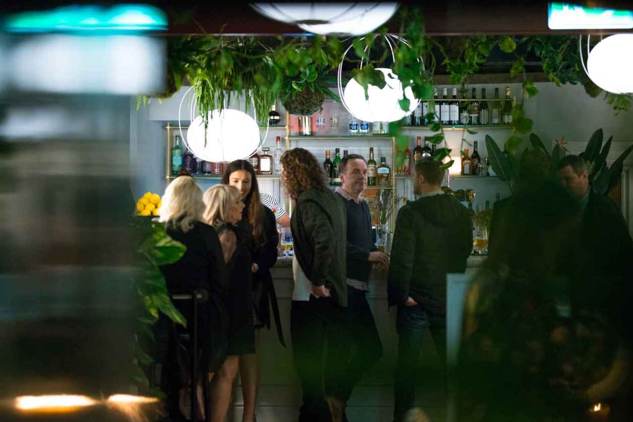 people-drinking-at-the-bar-of-the-butterfly-and-the-grasshopper