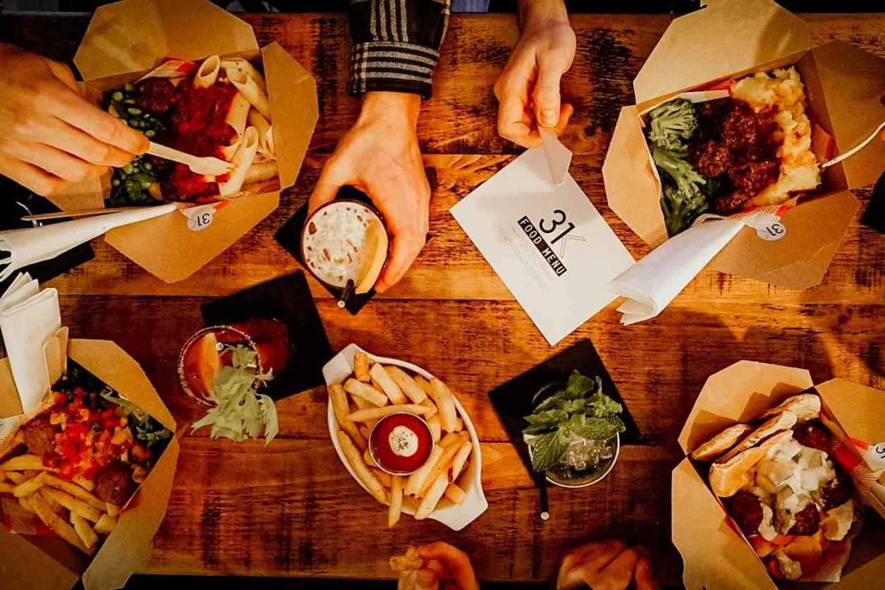 people-eating-from-boxes-and-bowls-of-food-at-31k-restaurant-vegan-restaurants-nottingham