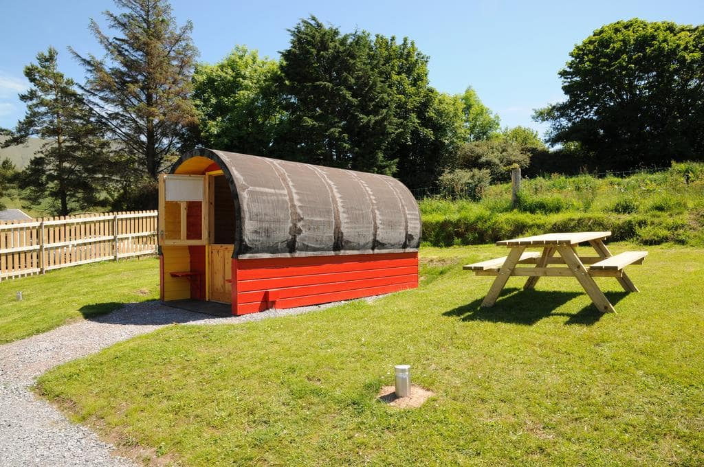 red-and-brown-coach-field-camp-pod-in-field