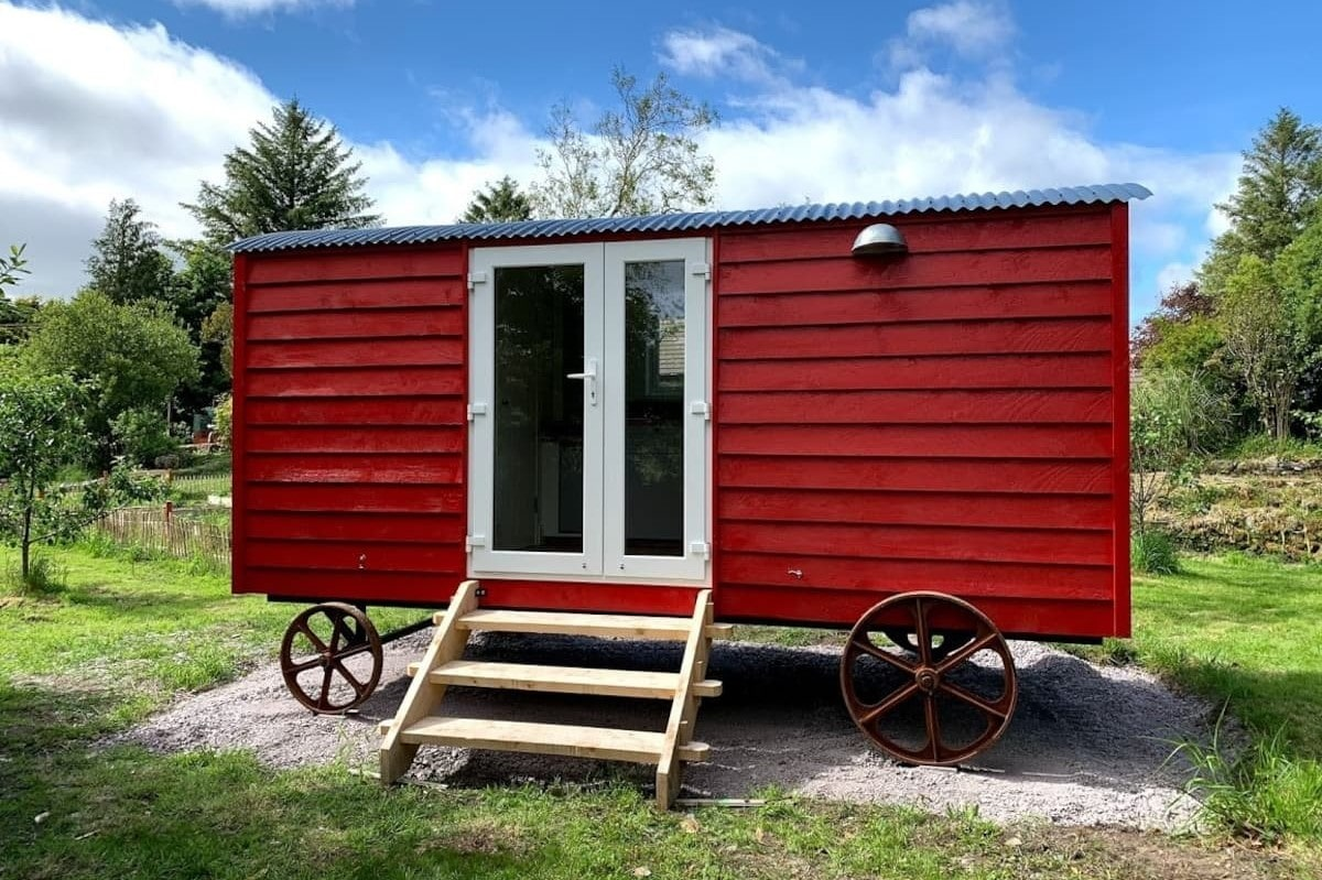 red-aoife-shepherds-hut-on-wheels-in-field-glamping-cork