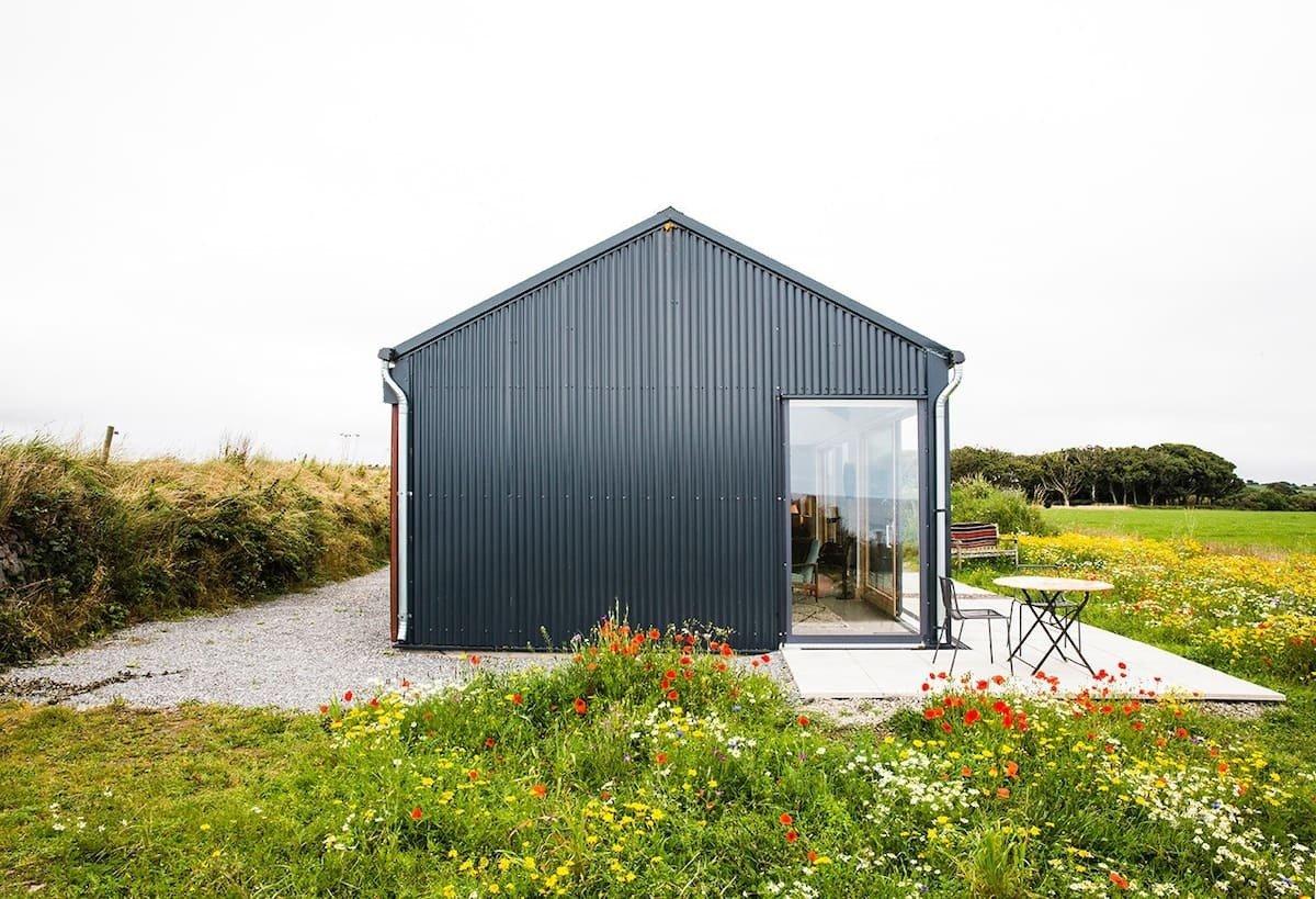 secluded-black-coastal-studio-in-flowery-field