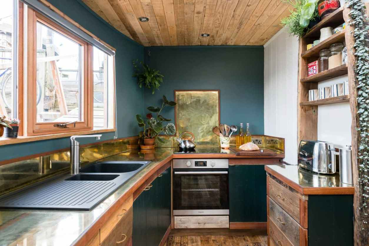 teal-and-gold-kitchen-of-the-raft-houseboat