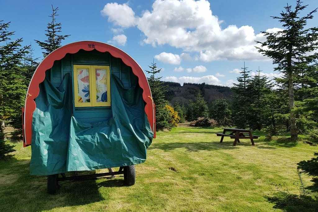 teal-and-red-gypsy-caravan-in-field-at-clissmann-horse-caravans-glamping-wicklow