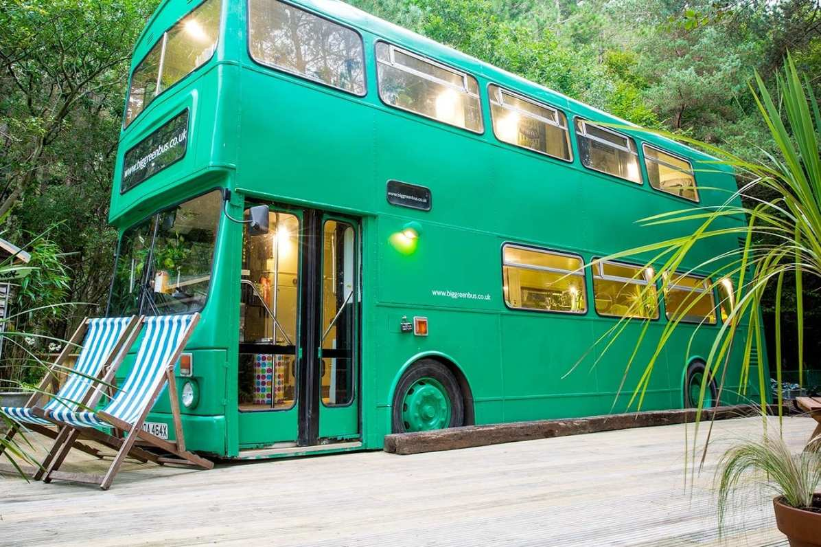 the-big-green-bus-double-decker-on-decking-in-woodland