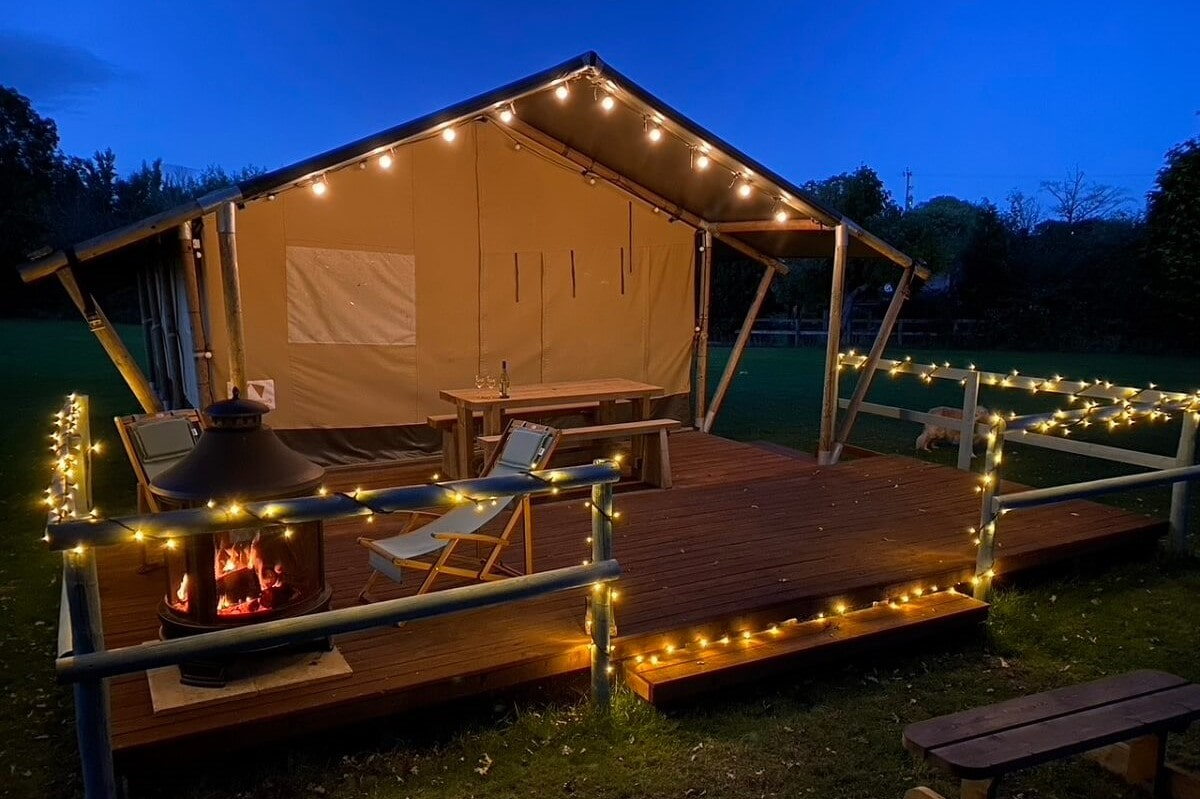 the-firs-safari-tent-lit-up-by-fairy-lights-at-night