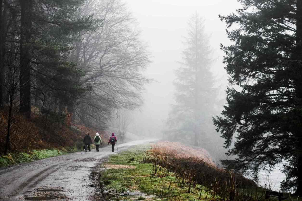 three-women-walking-around-a-reservoir-on-a-misty-day