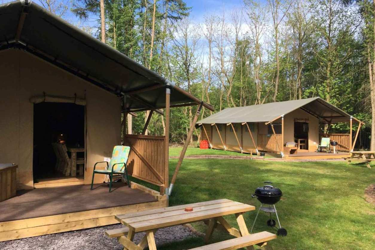 two-worth-forest-glamping-safari-tents-in-field