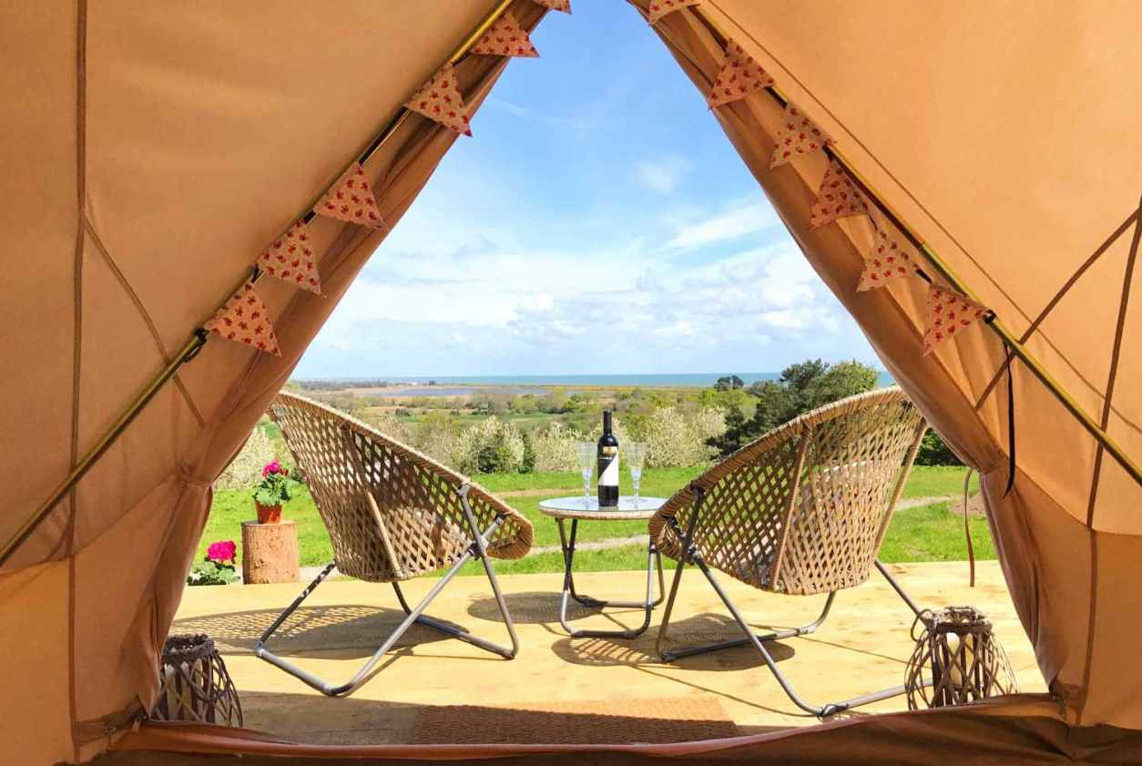 view-of-decking-and-fields-from-inside-tent-at-knockrobin-bell-tents-glamping-wicklow