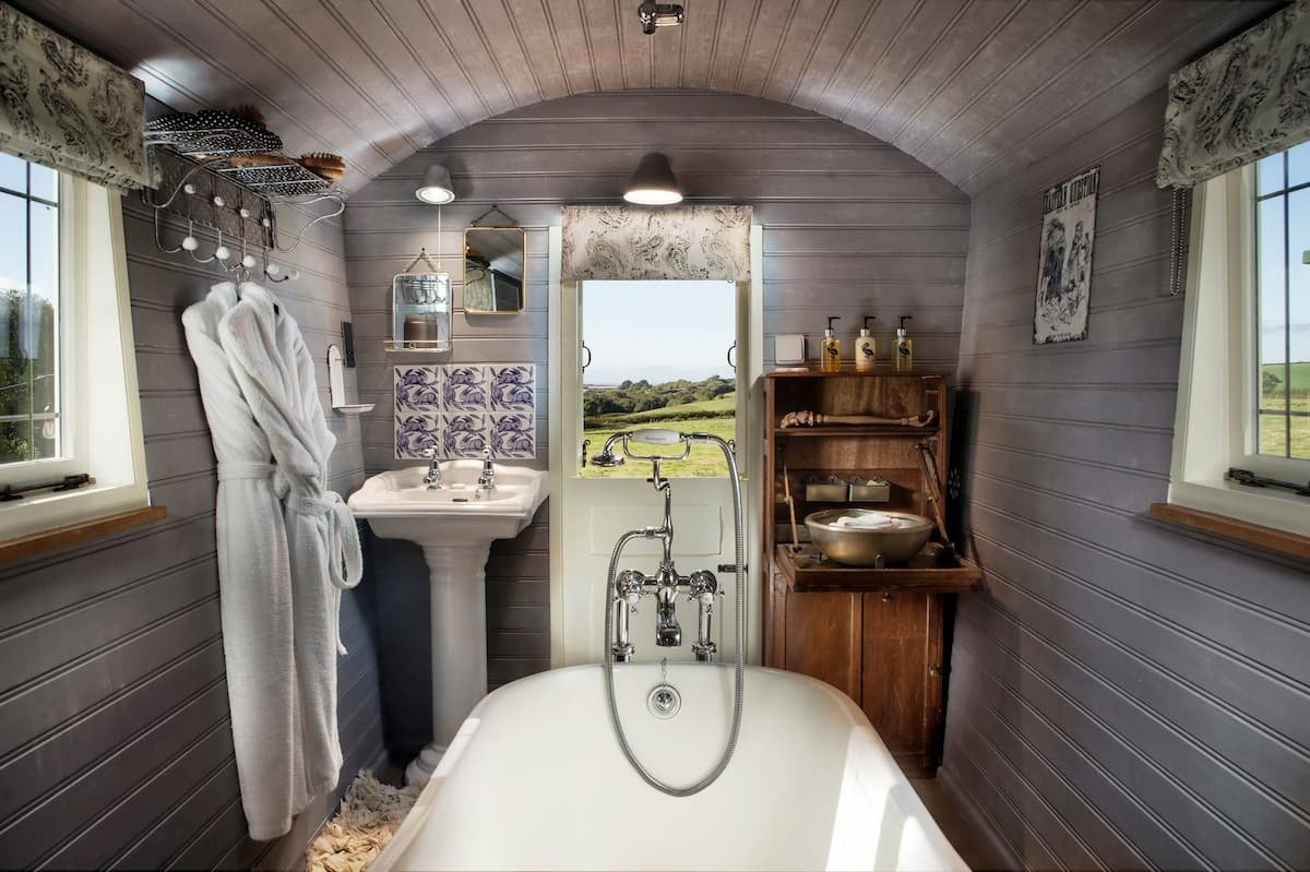white-roll-top-bath-sink-and-robes-inside-wagon