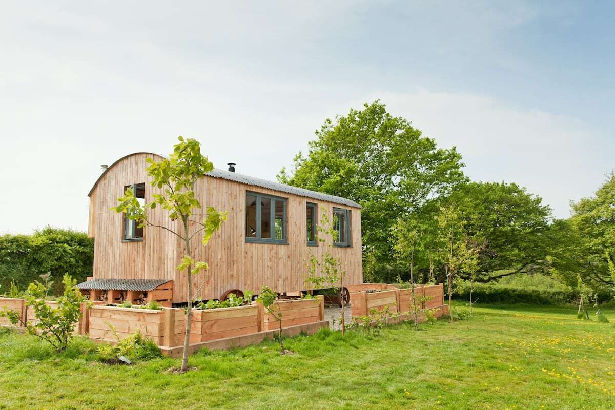 coastal-eco-shepherds-hut-on-gravel-in-field-glamping-south-wales