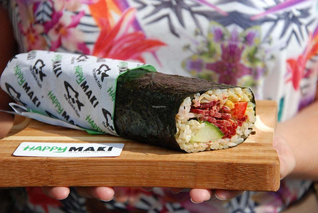 hand-holding-sushi-at-happy-maki