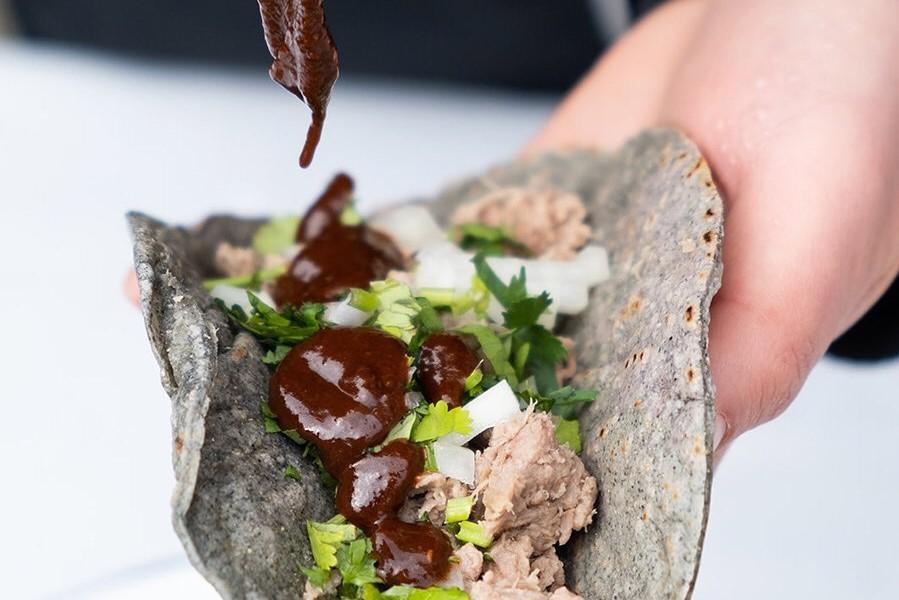 hand-holding-vegetarian-taco-at-casa-azul